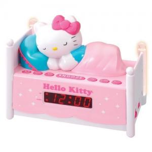Officially Licensed Hello Kitty KT2052 Alarm Clock Radio with Bed Post NIGHT LIGHTS! Wake to Radio or Alarm ~ Large, Easy to Locate Snooze Button ~ Two Bedposts Light Up for Night Light (On/Off Switch) ~ Built in cord ~ Battery Backup ~ This pink alarm cl
